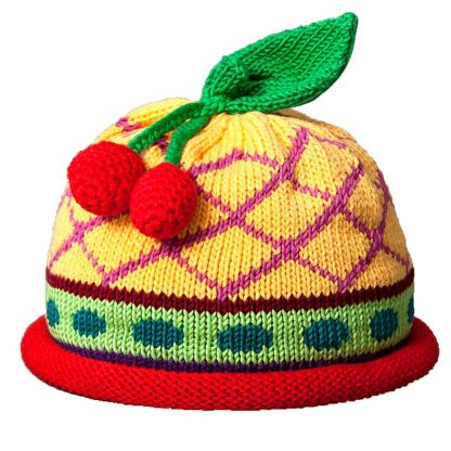 Cherries knit hat hot pink diamond pattern on yellow cap, has a green polka dot stripe above the red rolled brim