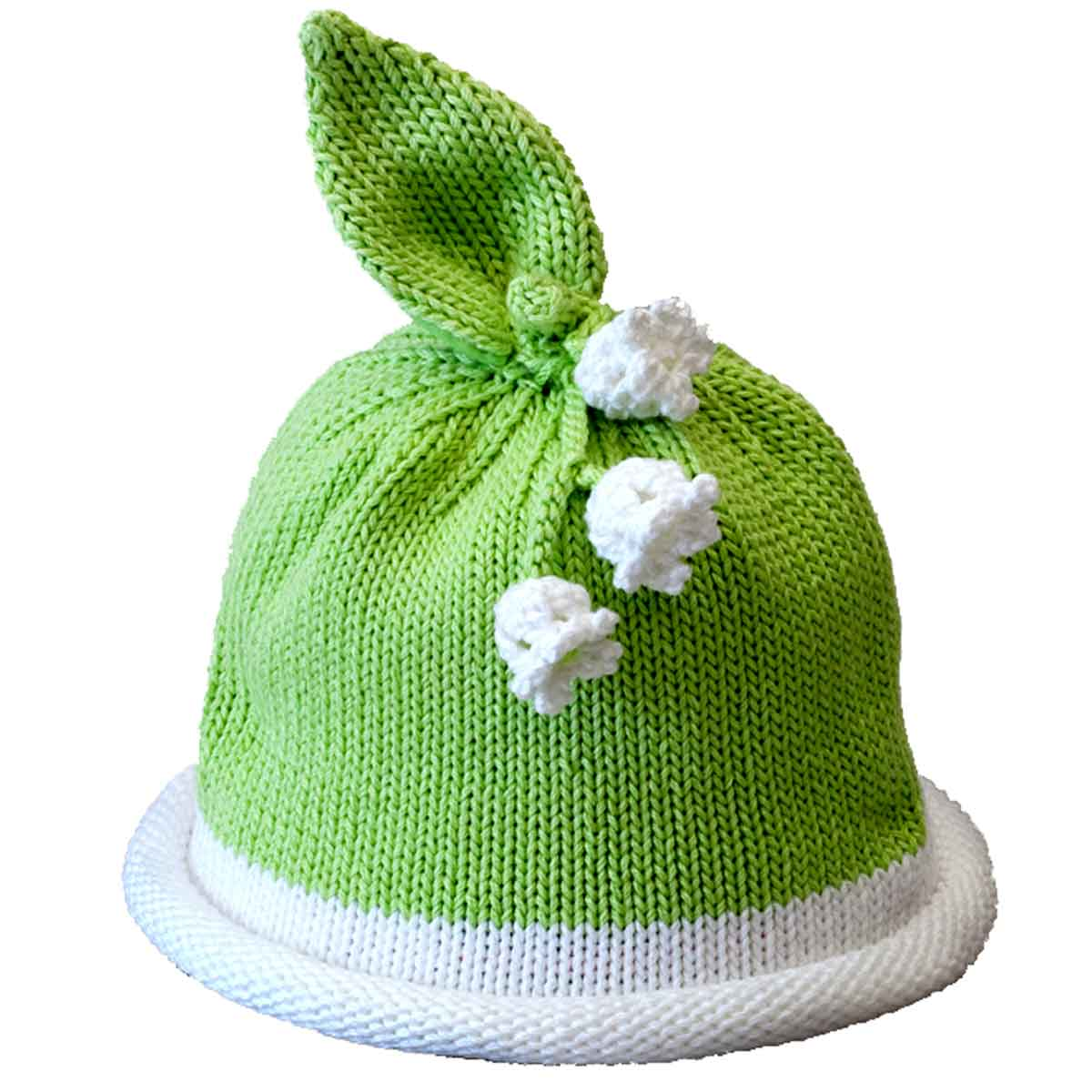 Green knit hat with white rolled brim topped with cluster of white knit  lily flowers and 8e44109b7b0