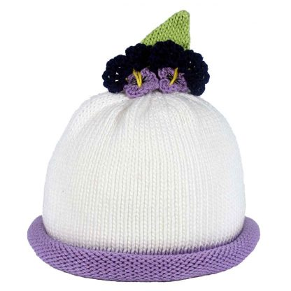 white knit hat with purple roll, 2 purple pansies on top, green leaf