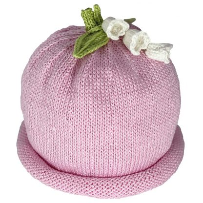 Pink knit hat decorated white lilies and green knit leaves
