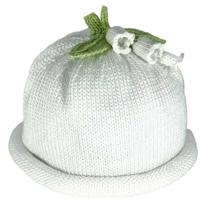 White knit hat decorated white lilies and green knit leaves