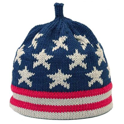 USA flag inspired knit hat in navy, red and beige. The cap is navy with beige stars and the brim is red and beige striped.