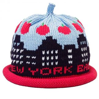 knit hat decorated with black skyline of tall buildings with blue sky and a ring of apples