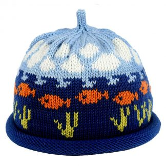 Knit hat decorated with orange fish swimming in a deep blue ocean with partly cloudy skies above